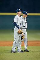 Jackson Raper (14) and Jeremy Simpson (3) of the Catawba Indians watch the new pitcher warm-up during the game against the Belmont Abbey Crusaders at Abbey Yard on February 7, 2017 in Belmont, North Carolina.  The Crusaders defeated the Indians 12-9.  (Brian Westerholt/Four Seam Images)