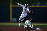 Winston-Salem Dash shortstop Yolbert Sanchez (2) reaches for a throw as Liover Peguero (10) of the Greensboro Grasshoppers steals second base at Truist Stadium on June 15, 2021 in Winston-Salem, North Carolina. (Brian Westerholt/Four Seam Images)