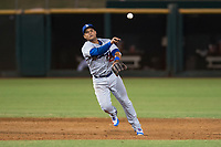 AZL Dodgers shortstop Donovan Solano (26) throws to first base during an Arizona League game against the AZL Indians 2 at Goodyear Ballpark on July 12, 2018 in Goodyear, Arizona. The AZL Indians 2 defeated the AZL Dodgers 2-1. (Zachary Lucy/Four Seam Images)