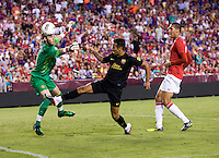 Thiago (4) of Barcelona tries to take a shot on David De Gea (1) of Manchester United during the friendly at FedEX Field in Landover, MD.  Manchester United defeated FC Barcelona, 2-1.