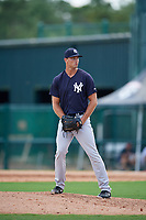 GCL Yankees West relief pitcher Kyle Johnson (22) gets ready to deliver a pitch during the first game of a doubleheader against the GCL Braves on July 30, 2018 at Champion Stadium in Kissimmee, Florida.  GCL Yankees West defeated GCL Braves 7-5.  (Mike Janes/Four Seam Images)