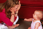 8 month old baby girl with mother interaction playing peek aboo horizontal