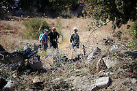 Pictured: Police officers and workers involved with clearing the new site of the search, where rubble was deposited from the farmhouse where Ben Needham disappeared from in Kos, Greece. Thursday 06 October 2016<br />