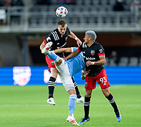 WASHINGTON, DC - APRIL 17: Frederic Brillant #13 and Tony Alfaro #93 of D.C. United go up for a header with Valentin Castellanos #11 of New York City FC during a game between New York City FC and D.C. United at Audi Field on April 17, 2021 in Washington, DC.