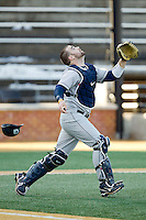 Georgetown Hoyas catcher Nick Collins (33) tracks a pop fly against the Wake Forest Demon Deacons at Wake Forest Baseball Park on February 16, 2014 in Winston-Salem, North Carolina.  The Demon Deacons defeated the Hoyas 3-2.  (Brian Westerholt/Four Seam Images)