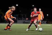 Brittany Bock (21) of the Western New York Flash dribbles the ball during the second half of a Women's Professional Soccer (WPS) match against Sky Blue FC at Sahlen's Stadium in Rochester, NY May 06, 2011. Western New York 3, Sky Blue FC 1.
