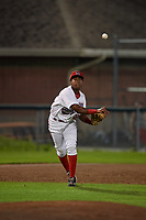 Auburn Doubledays third baseman Omar Meregildo (18) throws to first base during a game against the State College Spikes on August 21, 2017 at Falcon Park in Auburn, New York.  Auburn defeated State College 6-1.  (Mike Janes/Four Seam Images)