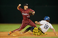 Macon Bacon second baseman Trevor Austin (43) throws to first base as Daniel Oberst (28) slides in during a Coastal Plain League game against the Savannah Bananas on July 15, 2020 at Grayson Stadium in Savannah, Georgia.  (Mike Janes/Four Seam Images)