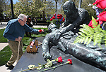 Rex T. Baggett, of Carson City, lays a flower on the memorial following the 21st annual Nevada State Law Enforcement Officers Memorial ceremony in Carson City, Nev., on Thursday, May 3, 2018. <br />Photo by Cathleen Allison/Nevada Momentum