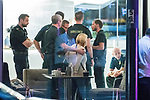 © Joel Goodman - 07973 332324 . 10/08/2017. Salford, UK. Police , paramedics and bystanders in the foyer of the Marriott Hotel which is next door to and shares a car park with the Ibis Hotel .  The scene at the Ibis hotel in Salford Quays where a young boy was killed in a collision with a car earlier this evening (Thursday 10th August 2017) . Photo credit : Joel Goodman