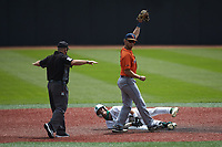 UTSA Roadrunners shortstop Joshua Lamb (2) holds up the ball as third base umpire Mike Mazza calls Carson Johnson (2) of the Charlotte 49ers safe at second base at Hayes Stadium on April 18, 2021 in Charlotte, North Carolina. (Brian Westerholt/Four Seam Images)