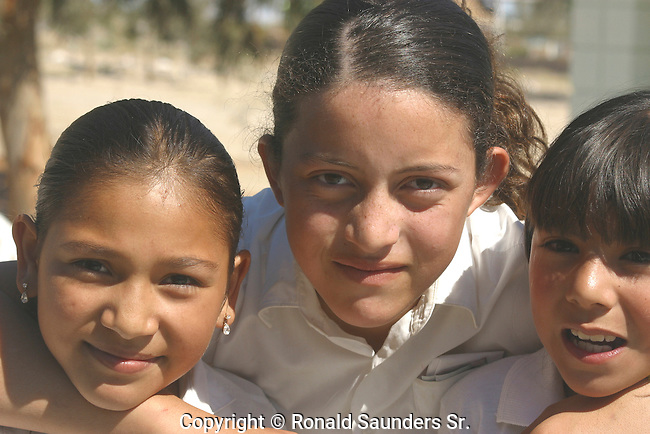 THREE SCHOOL CHILDREN TAKE a CLOSE-UP PHOTO
