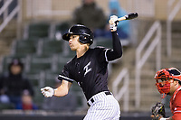 Zach Remillard (8) of the Kannapolis Intimidators follows through on his swing against the Lakewood BlueClaws at Kannapolis Intimidators Stadium on April 6, 2017 in Kannapolis, North Carolina.  The BlueClaws defeated the Intimidators 7-5.  (Brian Westerholt/Four Seam Images)