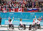 Sochi, RUSSIA - Mar 15 2014 - Sonja Gaudet, Jim Armstrong, Ina Forrest and Dennis Thiessen celebrate their gold medal win in the Gold Medal Wheechair Curling match at the 2014 Paralympic Winter Games in Sochi, Russia.  (Photo: Matthew Murnaghan/Canadian Paralympic Committee)