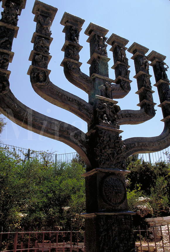 This Menorah was sculpted by modern Israeli artist, Benno Elkan, to commemorate the Jewish religion. It is positioned in front of the Knesset (Parliament building) in Jerusalem. Hanukkah, or Chanukah, a Jewish holiday which commemorates the victory o f Ju