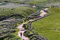 Pictured: People walk up and down the path leading to Pen-y-Fan, one of the Brecon Beacons summits near Storey Arms in the Brecon Beacons, Wales, UK. Sunday 13 June 2021<br /> Re: High temperatures and sunshine has been forecast for most of the UK.