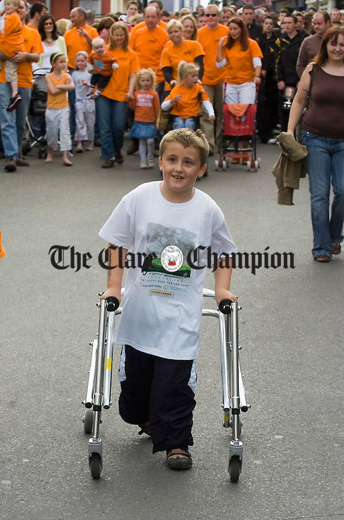 Young Evan Whelan helps to lead the procession for Tony Griffin at Ennis. Photograph by John Kelly.