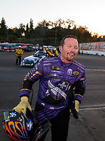 Nov 17, 2019; Pomona, CA, USA; NHRA funny car driver Jack Beckman celebrates after winning the Auto Club Finals at Auto Club Raceway at Pomona. Mandatory Credit: Mark J. Rebilas-USA TODAY Sports