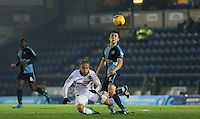 Luke O'Nien of Wycombe Wanderers & Curtis Thompson of Notts County during the Sky Bet League 2 match between Wycombe Wanderers and Notts County at Adams Park, High Wycombe, England on 15 December 2015. Photo by Andy Rowland.