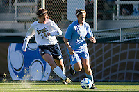 North Carolina Tar Heels forward Casey Nogueira (54) is marked by Notre Dame Fighting Irish midfielder Courtney Rosen (14) during the first half. The North Carolina Tar Heels defeated the Notre Dame Fighting Irish 2-1 during the finals of the NCAA Women's College Cup at Wakemed Soccer Park in Cary, NC, on December 7, 2008. Photo by Howard C. Smith/isiphotos.com