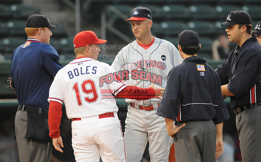 Sept. 18, 2009: Managers Kevin Boles and Dusty Wathan meet with the umpires before the game. The Lakewood BlueClaws won Game 4 of the South Atlantic League Championship Series against the Greenville Drive 5-1 at Fluor Field at the West End in Greenville, S.C. Lakewood won the series 3 games to 1. Photo by: Tom Priddy/Four Seam Images