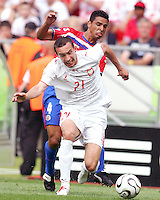 Ireneusz Jelen (21) of Poland gets in front of Michael Umana (4) of Costa Rica. Poland defeated Costa Rica 2-1 in their FIFA World Cup Group A match at FIFA World Cup Stadium, Hanover, Germany, June 20, 2006.