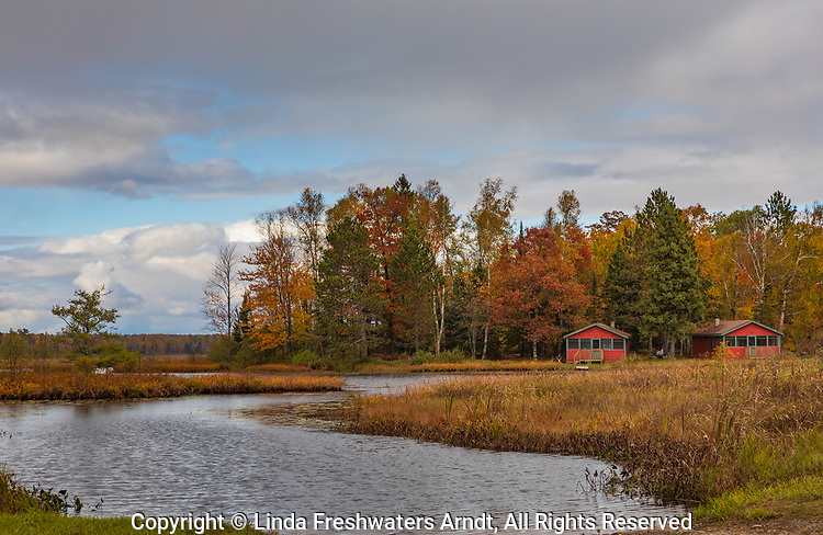 Two log cabins on Fishtrap Lake in northern Wisconsin.