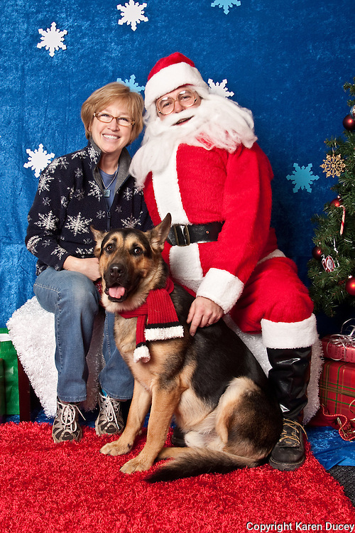 Elizabeth Leith and her dog Sarge, pose for a holiday photo with Santa at Pet Pros in Redmond, WA to help raise money for Dogs Deserve Better on December 11, 2010. (photo by Karen Ducey)