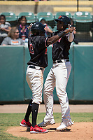 Visalia Rawhide right fielder Ramon Hernandez (16) receives a high five from Marcus Wilson (12) after hitting a two-run home run during a California League game against the Stockton Ports at Visalia Recreation Ballpark on May 9, 2018 in Visalia, California. Stockton defeated Visalia 4-2. (Zachary Lucy/Four Seam Images)