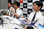 September 2011, Tokyo, Japan - Capt. Hideaki Hayakawa, center, and crew members of All Nippon Airways Co. attend a news conference after flying the first all-new Boeing 787 Dreamliner from Everett, Wash., to Tokyos Haneda Airport on Wednesday, September 28, 2011. The world's first carbon-composite passenger jetliner will make commercial flights on a route between Narita International Airport, east of Tokyo, and Hong Kong. (Photo by AFLO) [3609] -mis-