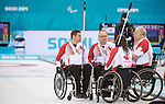 Sochi, RUSSIA - Mar 10 2014 -  Canada's Wheelchair curling team discuss strategy between ends during Canada vs USA in Wheelchair Curling round robin play at the 2014 Paralympic Winter Games in Sochi, Russia.  (Photo: Matthew Murnaghan/Canadian Paralympic Committee)