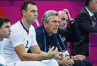 08 AUG 2012 - LONDON, GBR - Claude Onesta (FRA) (centre in blue), the head coach of France, watches play during the men's London 2012 Olympic Games quarter final match against Spain at the Basketball Arena in the Olympic Park, in Stratford, London, Great Britain (PHOTO (C) 2012 NIGEL FARROW)