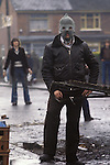 Ireland The Troubles. Belfast 1980s. IRA man in hood during riot. Probably taken in Etna Drive, Ardoyne north Belfast.