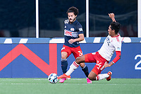 FOXBOROUGH, MA - JUNE 26: Rio Ramirez #24 of North Texas SC tackles Ryan Spaulding #34 of the New England Revolution during a game between North Texas SC and New England Revolution II at Gillette Stadium on June 26, 2021 in Foxborough, Massachusetts.