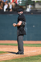 Umpire Garrett Griffin during a game between the Kingsport Axemen and the Bristol State Liners on June 13, 2021 at Boyce Cox Field in Bristol, Virginia. (Tracy Proffitt/Four Seam Images)