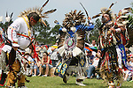 Charles Hankinson (Eagle Tail) (center), a Native American from the Micmac tribe of Canada, and Keith Anderson (right), his dancing brother, dance at the 8th Annual Redwing PowWow in Virginia Beach, Virginia.