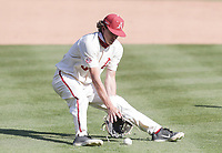 Arkansas infielder Jacob Nesbit (5) makes a catch, Saturday, April 3, 2021 during the ninth inning of a baseball game at Baum-Walker Stadium in Fayetteville. Check out nwaonline.com/210404Daily/ for today's photo gallery. <br /> (NWA Democrat-Gazette/Charlie Kaijo)