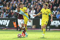 Fabio Fornals of West Ham tries to shake off a challenge from Brentford's Christian Norgaard during West Ham United vs Brentford, Premier League Football at The London Stadium on 3rd October 2021