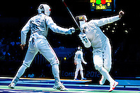31 JUL 2012 - LONDON, GBR - Artur Akhmatkhuzin (RUS) (right) of Russia parries an attack by Richard Kruse (GBR) (left) of Great Britain during their  round of 32 men's individual foil match at the ExCel Exhibition Centre in London Docklands, London, Great Britain .(PHOTO (C) 2012 NIGEL FARROW)