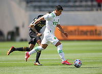LOS ANGELES, CA - APRIL 17: Nick Lima #24 of Austin FC moves with the ball during a game between Austin FC and Los Angeles FC at Banc of California Stadium on April 17, 2021 in Los Angeles, California.