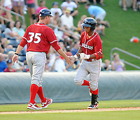 Infielder Edgar Duran (19) of the Lakewood BlueClaws is congratulated by manager Chris Truby after hitting a home run in a game against the Greenville Drive on July 12, 2011, at Fluor Field at the West End in Greenville, South Carolina. (Tom Priddy/Four Seam Images)