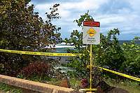 """Warning - Shark Sighted - Keep Out"" sign with yellow tape at Leftover's Surf Spot, North Shore, O'ahu"