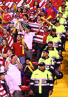 SAN JOSE, COSTA RICA - September 06, 2013: Police protect the fans of the USA MNT during a 2014 World Cup qualifying match against Costa Rica at the National Stadium in San Jose on September 6. USA lost 3-1.