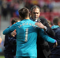 SUNDERLAND, ENGLAND - MAY 13: (L-R) Lukasz Fabianski of Swansea City hugs Swansea manager Paul Clement after the Premier League match between Sunderland and Swansea City at the Stadium of Light, Sunderland, England, UK. Saturday 13 May 2017