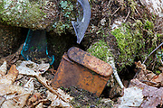 Artifact at an abandoned logging camp in Walker Ravine in Franconia Notch of the New Hampshire White Mountains during the spring months. This camp was likely part of the Johnson Lumber Company (Gordon Pond Railroad), and this is probably a tobacco tin. The type of tobacco that was in this tin is unknown. The removal of historic artifacts from federal lands without a permit is a violation of federal law.