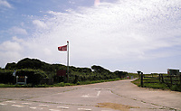 Thursday 15 June 2017<br />Pictured: A red flag flying by one of the gates of Castlemartin range.<br />Re: A soldier has been killed and three others injured after an incident involving a tank at a Ministry of Defence base in Pembrokeshire.<br />The soldier, from the Royal Tank Regiment, died in the incident at Castlemartin Range.<br />Two people were taken to Morriston Hospital in Swansea, while another casualty remains in Cardiff's University Hospital of Wales.<br />An investigation is under way.<br />Live firing was scheduled to take place at the range between Monday and Friday.<br />In May 2012, Ranger Michael Maguire died during a live firing exercise at the training base. An inquest later found he was unlawfully killed.