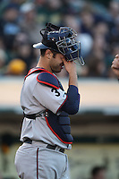OAKLAND, CA - JULY 30:  Joe Mauer #7 of the Minnesota Twins rubs his eyes against the Oakland Athletics during the game at the Oakland-Alameda County Coliseum on July 30, 2011 in Oakland, California. Photo by Brad Mangin