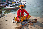 Snake charmer on the ghats of the Ganges River in Varanasi, Uttar Pradesh, India.