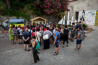 """Riace (Calabria, Italy), 04/08/2018. Visiting Riace for the third day of the """"Riace in Festival"""", 'Festival delle Migrazioni e delle Culture Locali' (Festival of Migration and Local Cultures). Attending the festival, amongst others, were the Mayor of Napoli Luigi De Magistris and the Mayor of Barcelona Ada Colau, debating with the Mayor of Riace, Domenico 'Mimmo' Lucano, about the so called """"migration crisis"""", as well as the now famous """"Modello Riace"""" (The Riace Model: how to welcome and work with Migrants to invest in building a future together). Other speakers included: Tiziana Barillà, Journalist at """"il Salto"""" (1) and Author of the book """"Mimi Capatosta. Mimmo Lucano e il modello Riace"""" (2),  Magistrates Riccardo De Vito and Emilio Sirianni (in turn President and Member of Magistratura Democratica). Chair of the event was Ilaria Bonaccorsi, Historian & Journalist at """"il Salto"""".<br /> From the Festival website: """"RIACE in FESTIVAL, is an event born in the wake of the policy of reception and resettlement of refugees and asylum seekers that the city administration of the """"Riace Bronzes'"""" town has been implementing for years. [...] The festival aims to be a concrete initiative that, through the universal language of cinema and the arts, promotes the exchange and mutual knowledge to counteract forms of closure and racism, drawing attention to the innovative path that the municipal administration of Riace has started by combining the reception of migrants with the revival of its territory and giving the image of an unpublished Calabria, different from that of the black chronicle>>.<br /> Riace is a small village in the province of Reggio Calabria. It's famous because on the 16 August 1972 Stefano Mariottini, a chemist from Rome, found two full-size Greek bronzes... (Riace Bronzes: https://bit.ly/2oBoFNY)<br /> (For the full caption read the ARTICLE at the the beginning of this story)"""