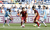 Calcio, Serie A: Lazio vs Roma. Roma, stadio Olimpico, 3 aprile 2016.<br /> Roma's Mohamed Salah, second from left, and Diego Perotti, second from right, are challenged by Lazio's Edson Braafheid, left, and Marco Parolo, during the Italian Serie A football match between Lazio and Roma at Rome's Olympic stadium, 3 April 2016.<br /> UPDATE IMAGES PRESS/Isabella Bonotto